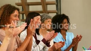 Smiling women clapping hands