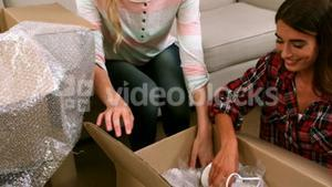 Woman helping her friend with unpacking