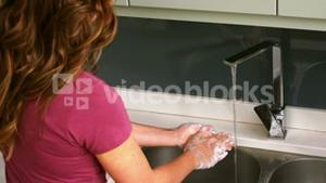 Woman cleaning her hands