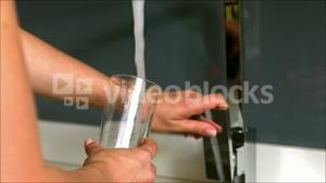 Woman pouring water in her glass