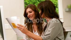 Friends holding paper with notes