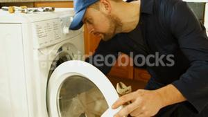 Man fixing the washing machine