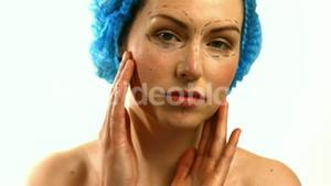 Patient touching her face