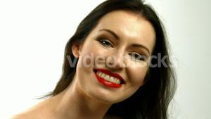 Woman putting red lipstick