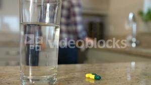 Woman cleaning and taking pills