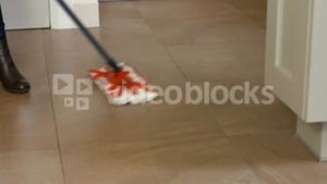 Woman using the mop for cleaning