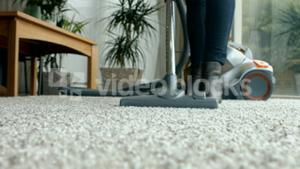 Woman using the vacuum cleaner