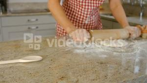 Woman baking with egg and flour