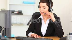 Brunette woman working with a computer