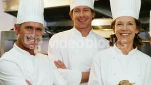 Chefs smiling in the commercial kitchen