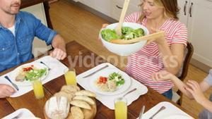 Family having dinner together in kitchen
