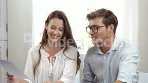 Cute couple working together on laptop