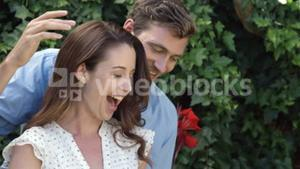 Happy man giving present to surprised wife