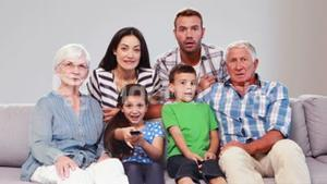 Extended family watching tv while changing channels