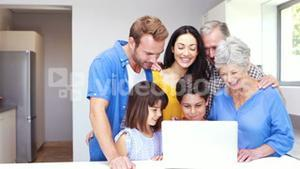 Happy family doing video chat on laptop