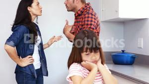 Couple arguing in front of their daughter