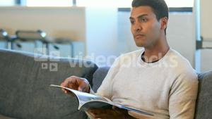 Man reading a magazine in a waiting room