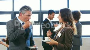 Business team talking and enjoying some coffee