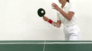 Woman serving in ping pong