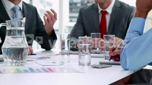 Business people working together at meeting in cinemagraph