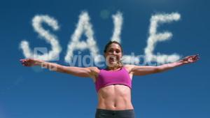 Fit smiling woman jumping
