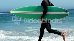 Man in wet suit running