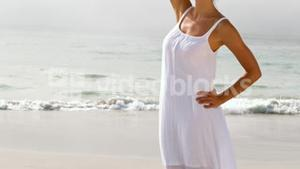 Woman in a white dress standing