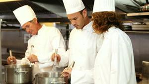 Group of chef talking and cooking