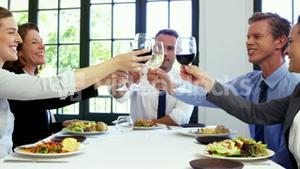 Business people toasting and having lunch