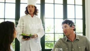 Pretty woman giving back her dish to chef