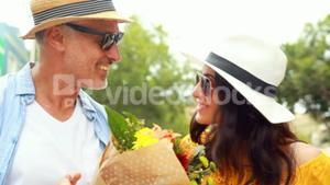 Smiling couple with flowers