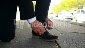 Businessman tying up his shoelaces
