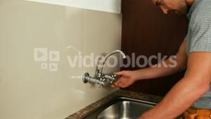 Man fixing the sink