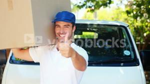 Delivery man carrying a parcel