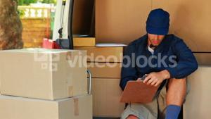 Delivery man counting the parcels