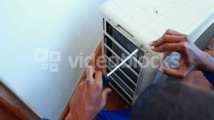 Repairman fixing air conditioning