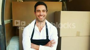 Smiling delivery man sitting in his van
