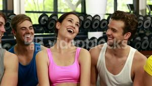 Athletic men and women laughing