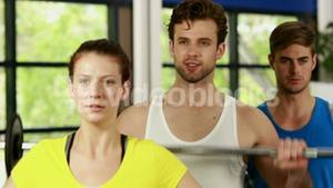 Athletic men and women working out