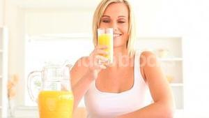 Blond woman pouring juice
