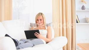 Beautiful woman relaxing with a tablet