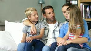 Cute family talking sitting on the couch