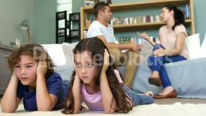 Couple arguing in front of children