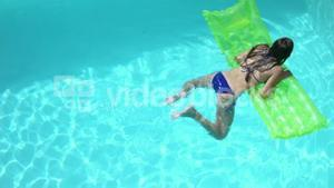 Attractive woman swimming in pool