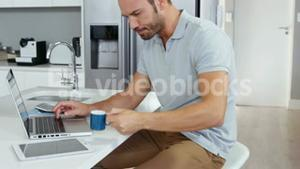 Handsome man working on laptop