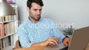 Concentrated man using laptop