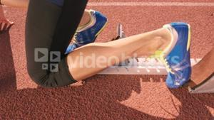 Athlete woman waiting in the starting block