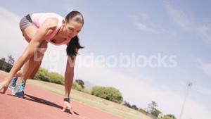 Focused sportswoman running