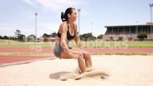 Sportswoman doing long jump