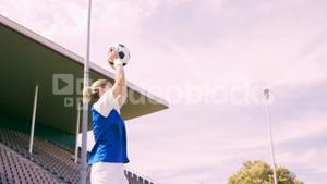 Football player throwing ball
